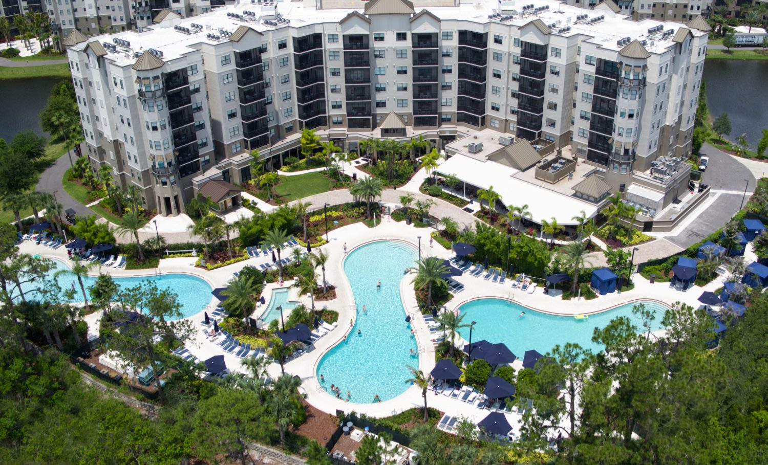 Aerial view of The Grove Resort & Spa's three pools.